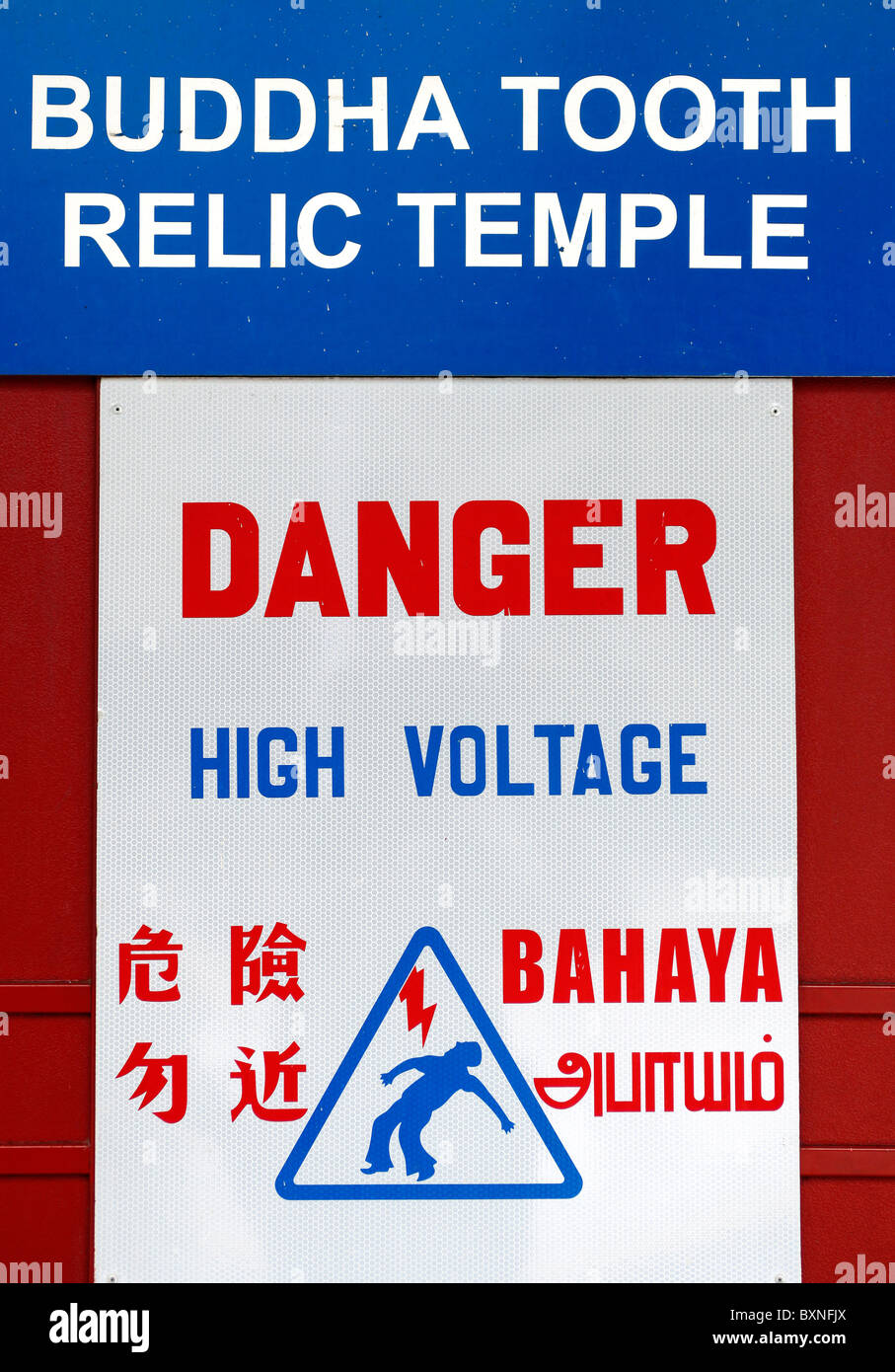 Singapore: warning sign on the Buddha Tooth Relic Temple in China Town - Stock Image