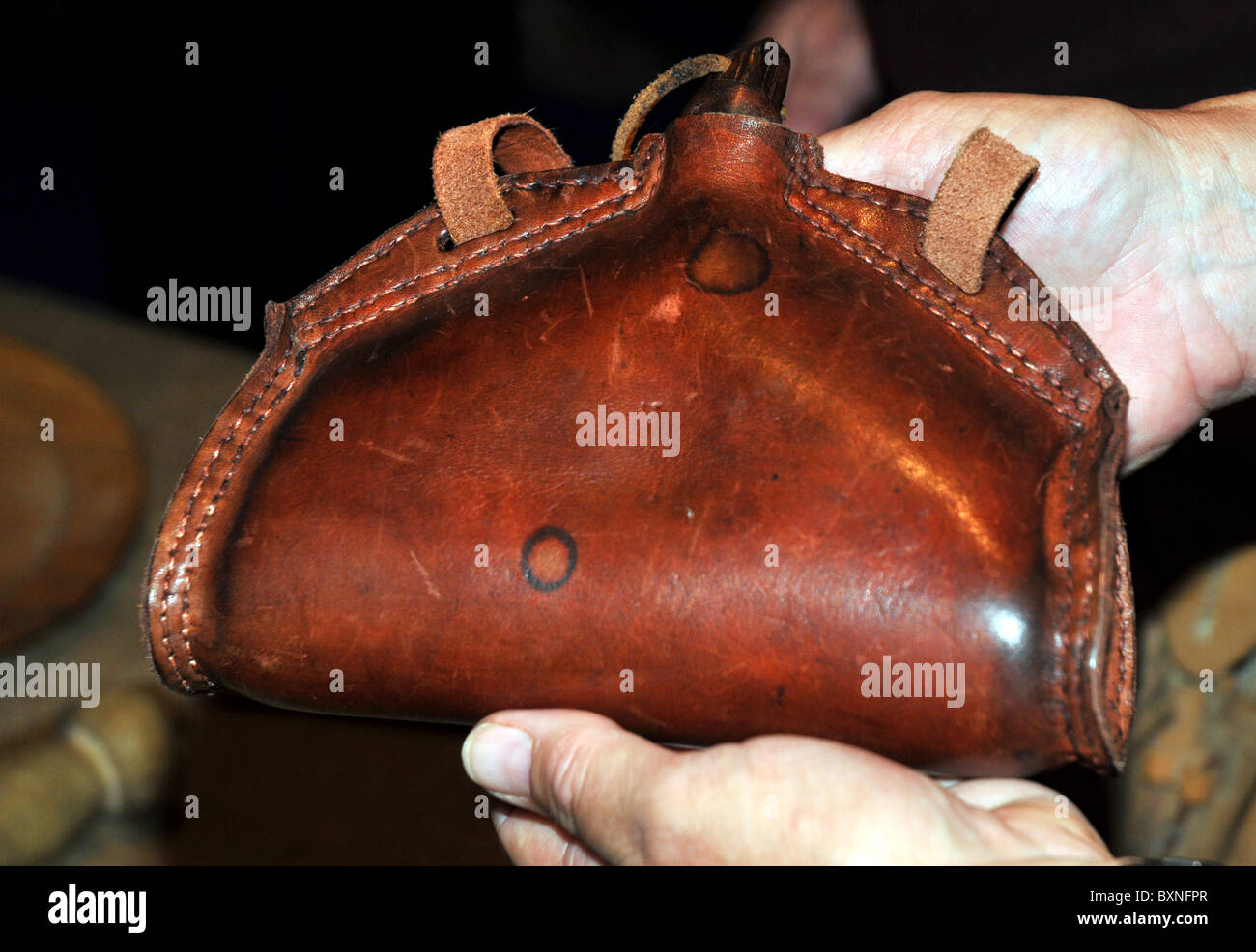 Leather water bottle, The Mary Rose Museum, Portsmouth Historic Dockyard, Hampshire, Britain, UK - Stock Image