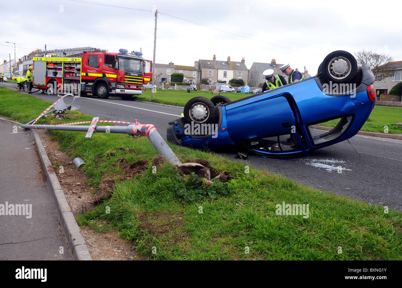 Car crash, overturned car after a traffic accident - Stock Image