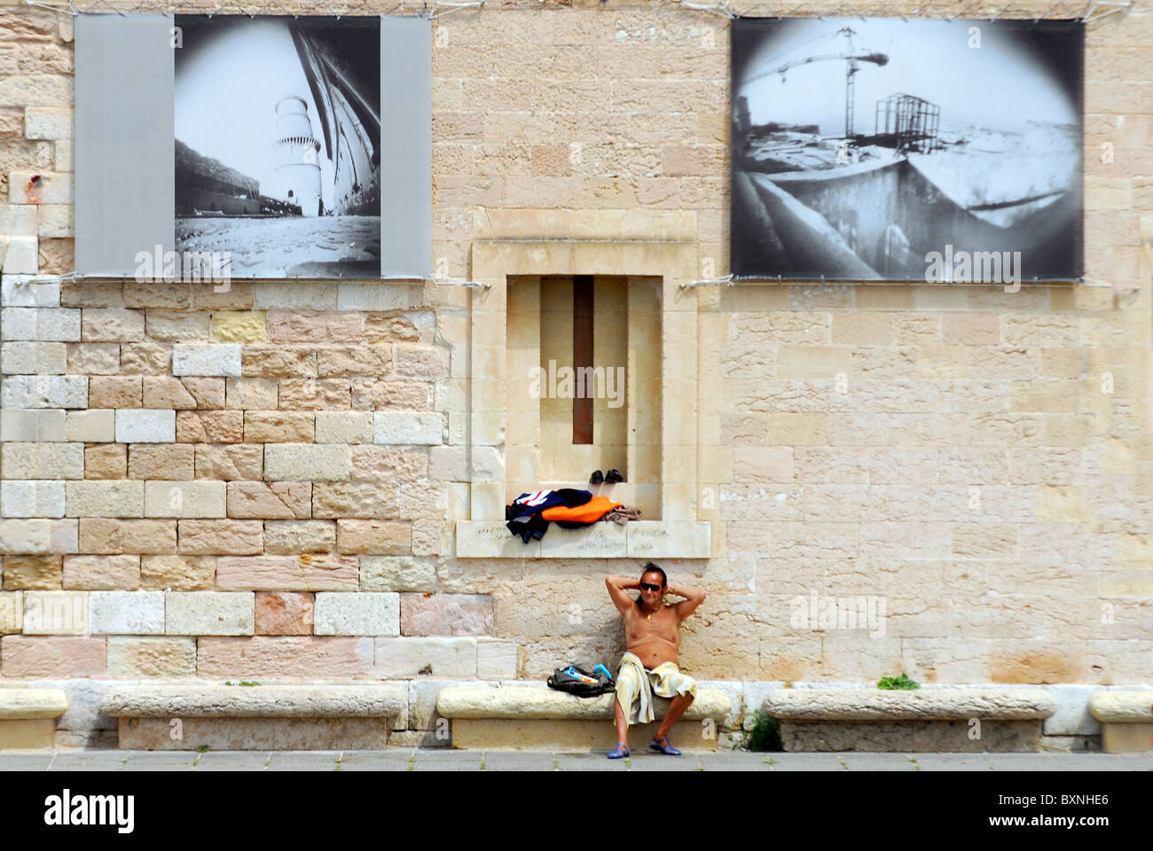 Sunbather on the port of Marseille in south France - Stock Image
