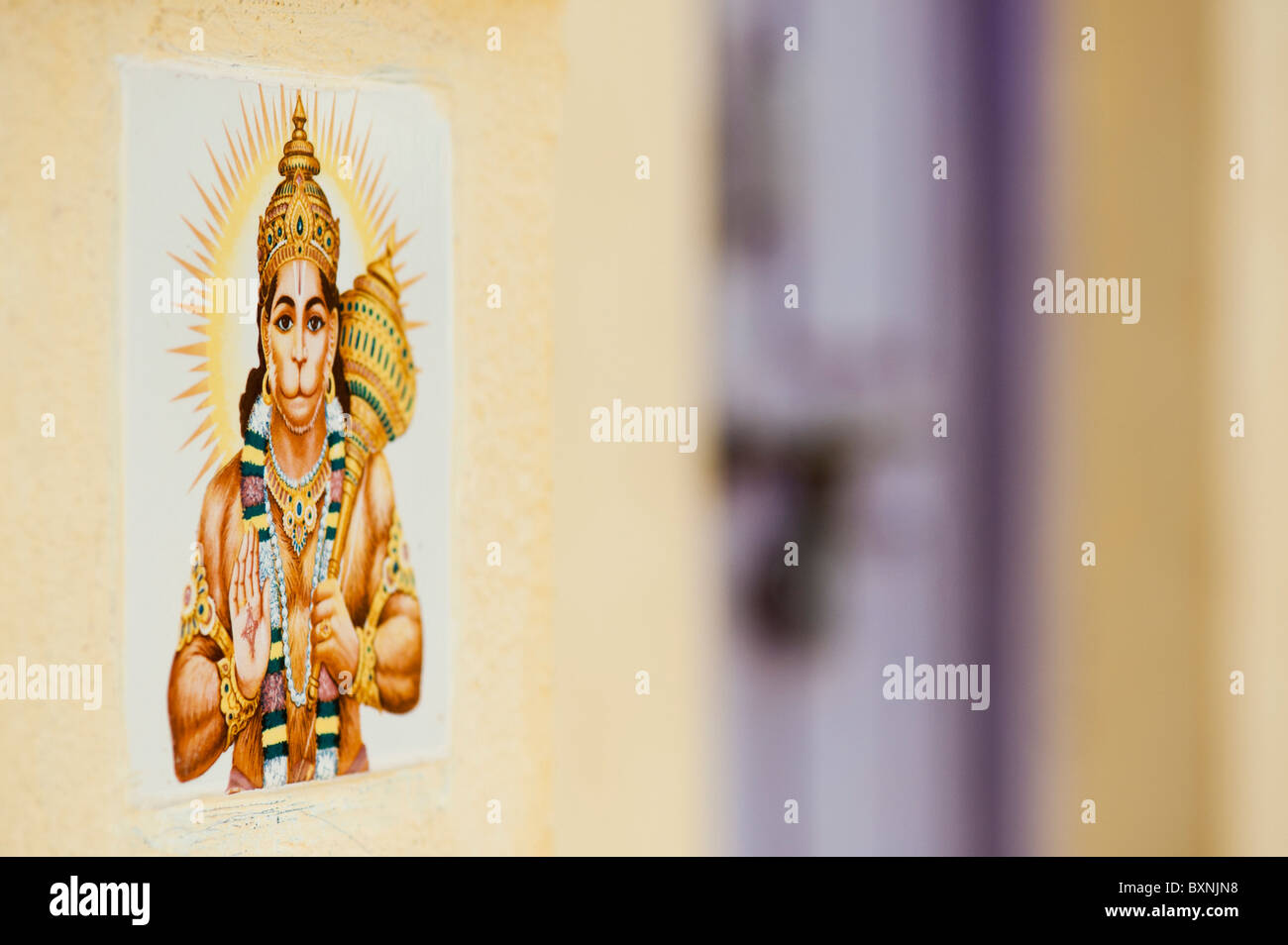 Hanuman ceramic wall tile on the front of an Indian house. Andhra Pradesh, India - Stock Image