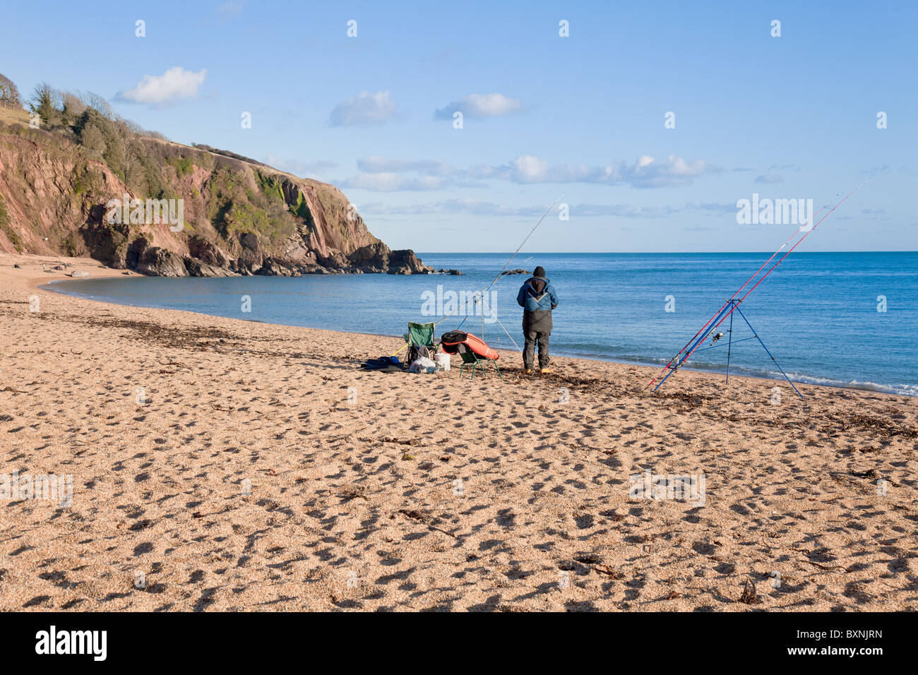 England Devon Blackpool Sands with fisherman - Stock Image