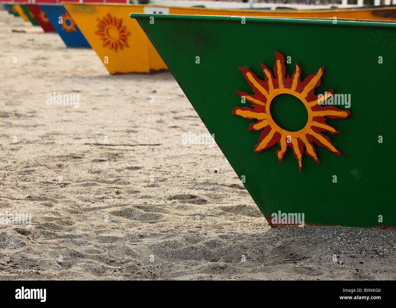 A row of boat shaped barbecues on Fuengirola beach - Stock Image