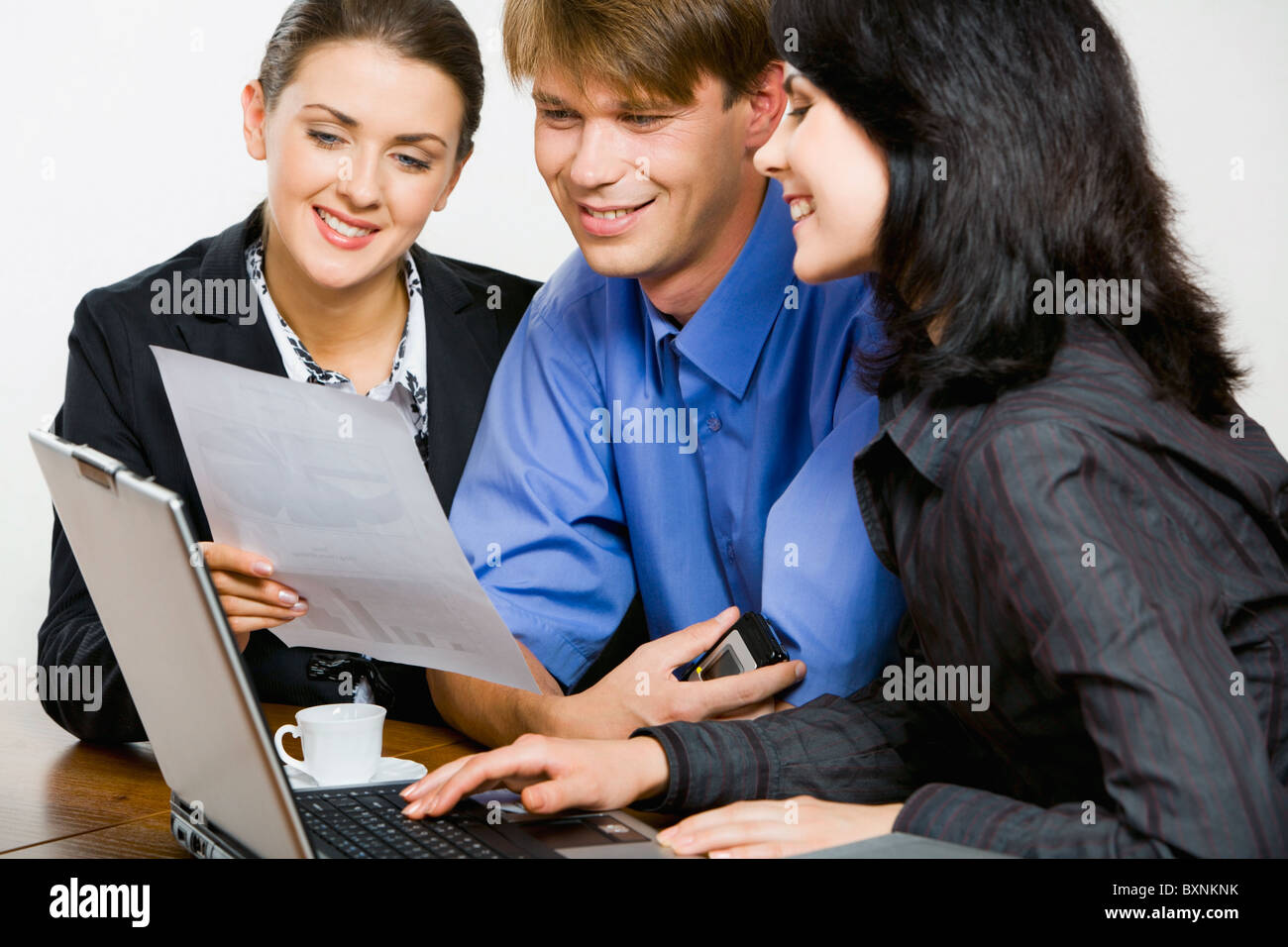 Confident professional demonstrates new strategy to her co-workers - Stock Image