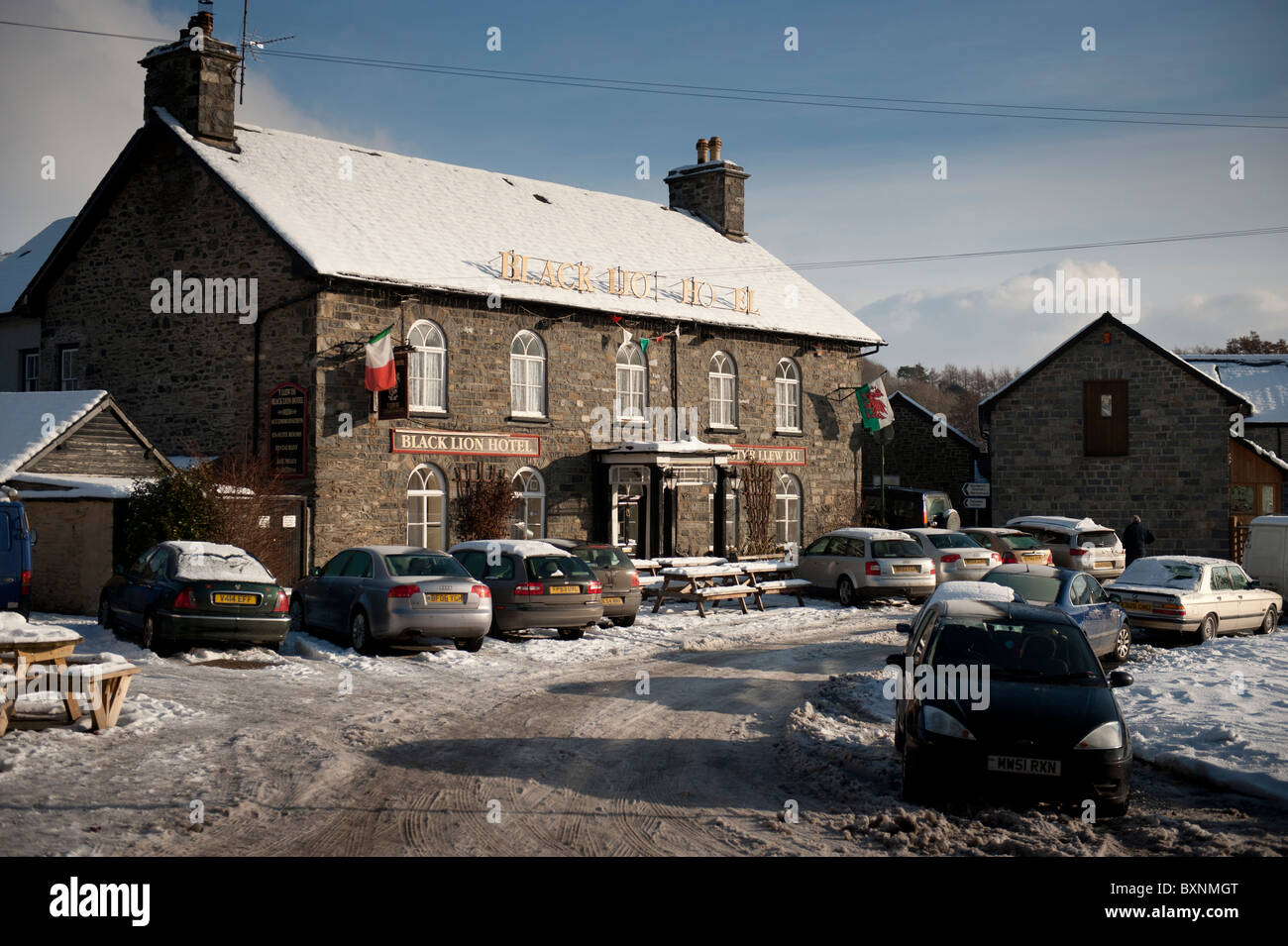 The Old Black Lion pub in the snow, Talybont, Ceredigion Wales UK - Stock Image