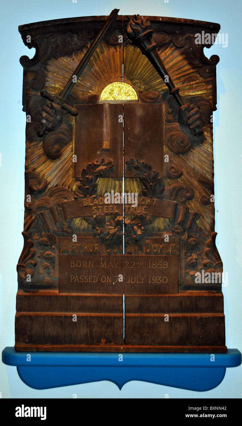 Wooden headstone of Sir Arthur Conan-Doyle at a special display in the Town's museum. Portsmouth, Hampshire, UK Stock Photo