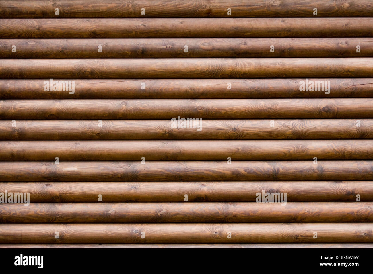 Horizontal image of wooden balks composing izba wall - Stock Image