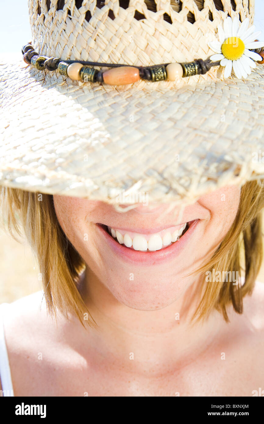 woman with straw hat - Stock Image