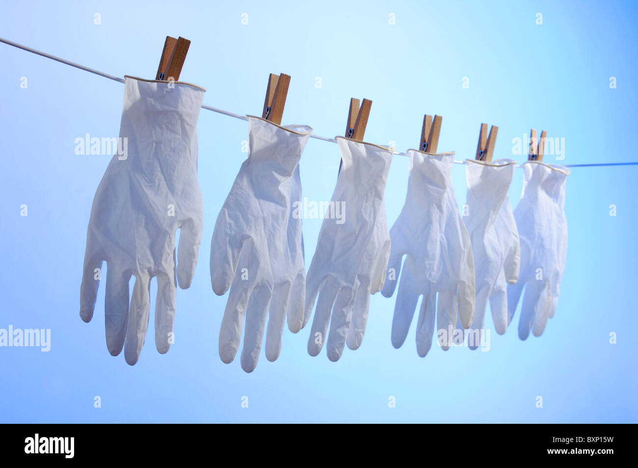 Latex gloves pegged on a washing line - Stock Image