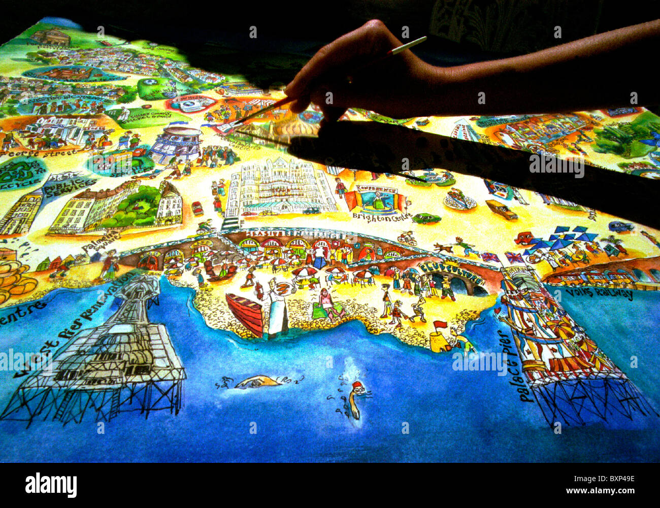 Artist Jo Ramm puts in the final details to a unique pictorial map of Brighton and Hove, entitled 'A Different - Stock Image