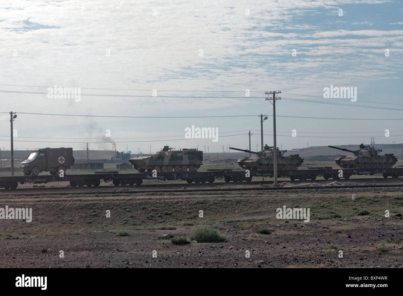Trans-Mongolian Express China Vistas - army vehicles - Stock Image