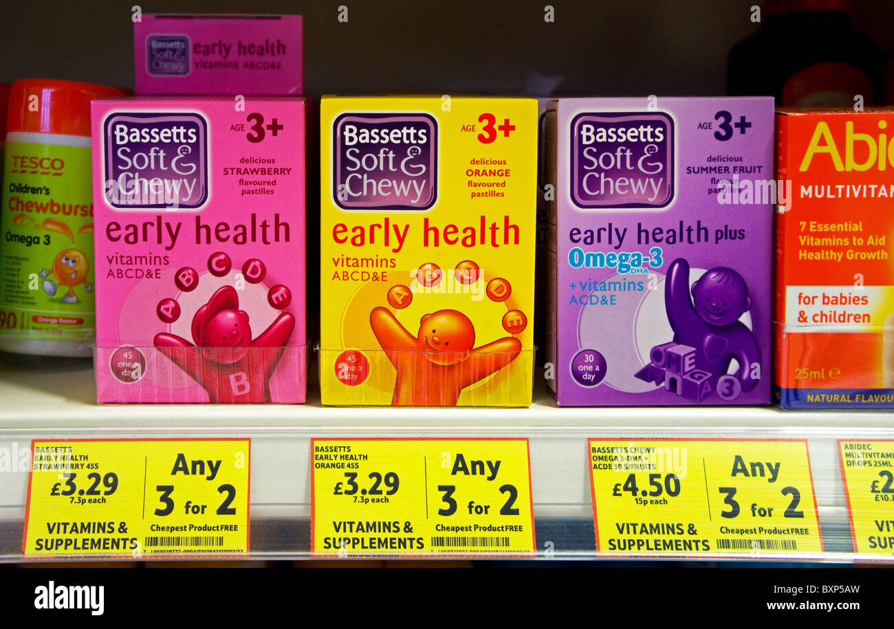 boxes of childrens vitamins tablets on a supermarket shelf - Stock Image