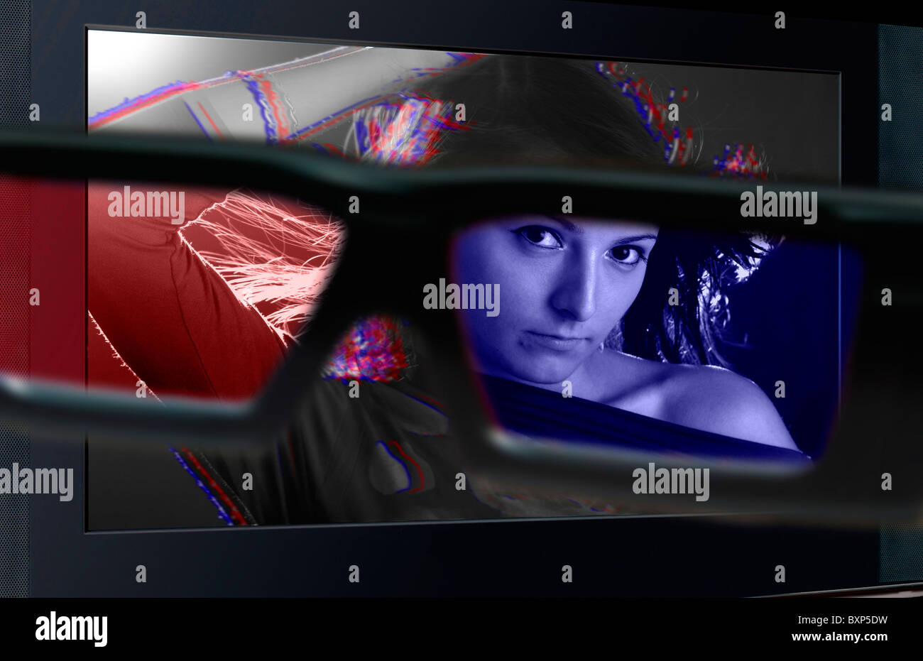 Glasses 3D in front of the TV with a woman. 3D television. - Stock Image