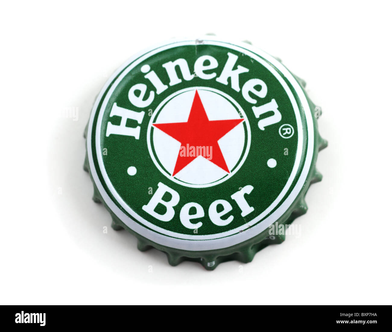 Heineken bottle cap on white background. Dutch brewing company. Stock Photo
