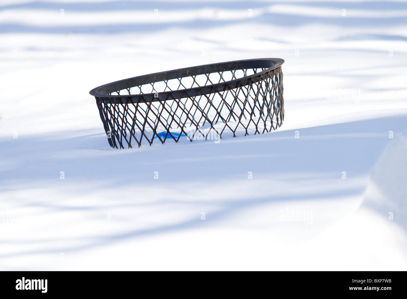 A trash can buried almost up to its rim in New York CIty's Riverside Park on the day after a blizzard hit the - Stock Image