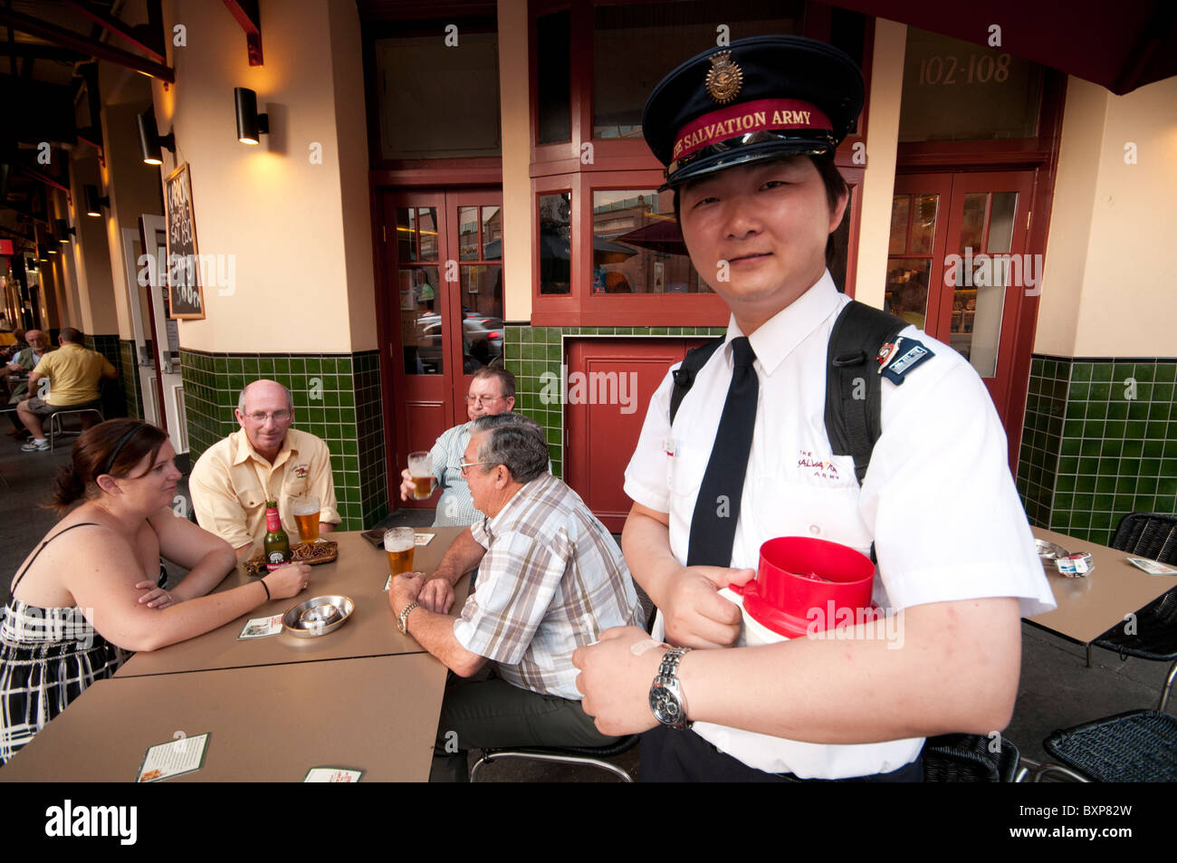 A Chinese Salvation Army member collecting money in the pubs of Chinatown in Sydney Australia - Stock Image