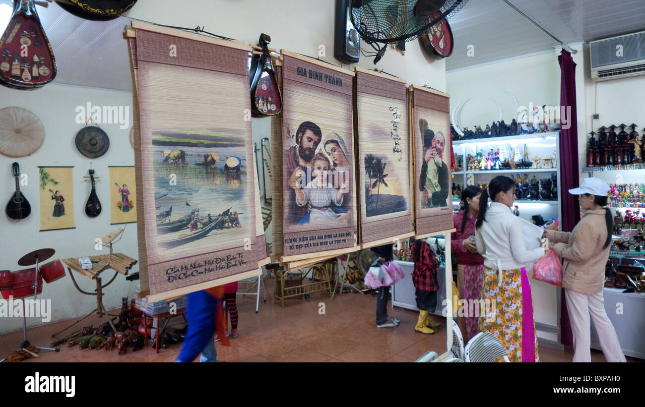 various iconography in a shop in Hanoi - Stock Image