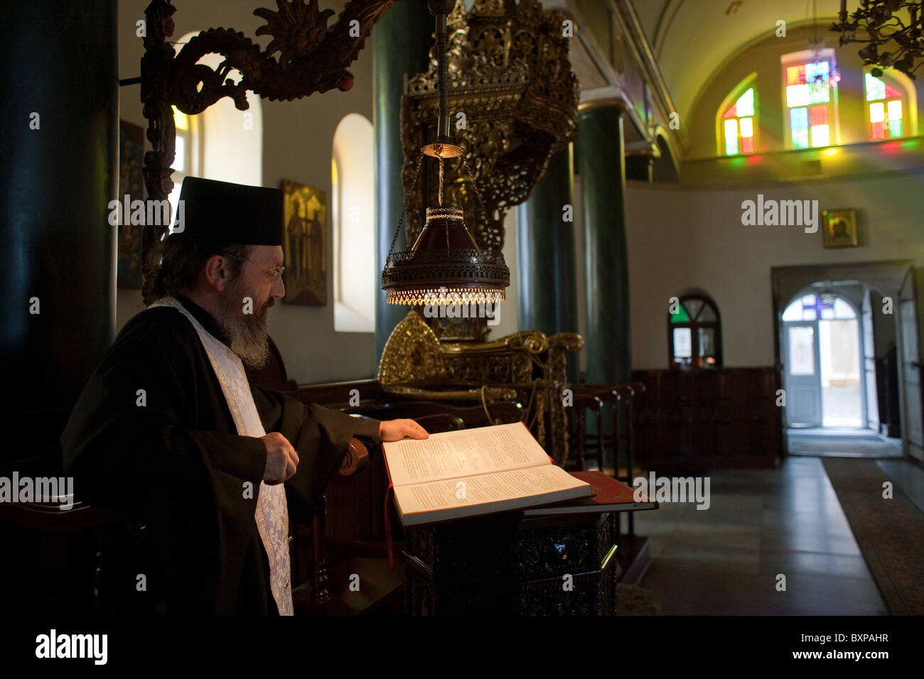 Greek Orthodox priest during the evening service, Heybeliada, Turkey - Stock Image