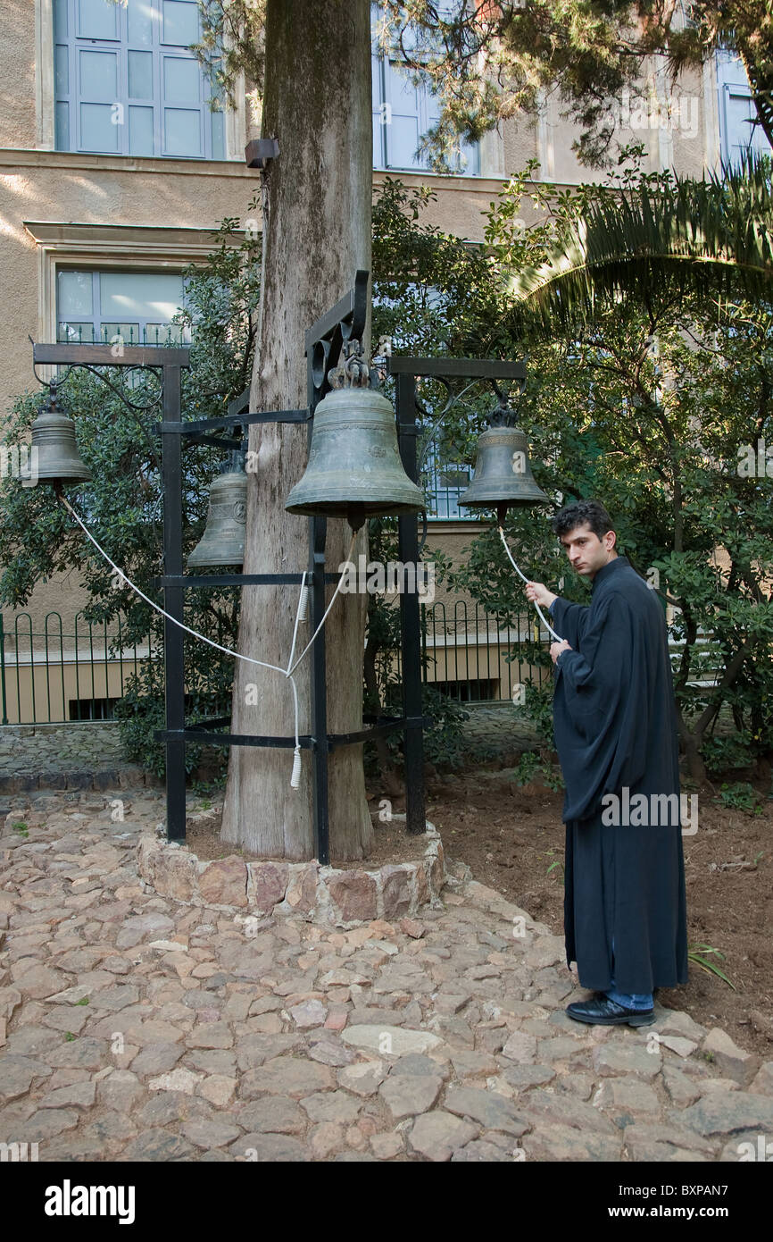 Acolyte tolling for the evening prayer, Heybeliada, Turkey - Stock Image