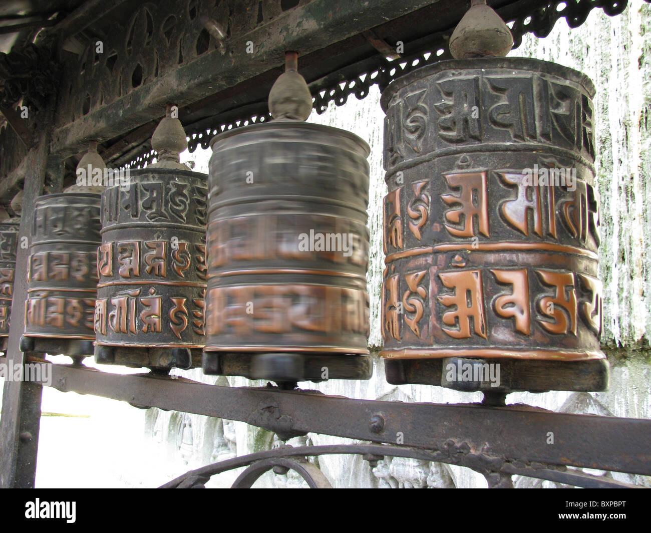 Buddhist prayer wheels in Bodnath stupa in Kathmandu, Nepal - Stock Image