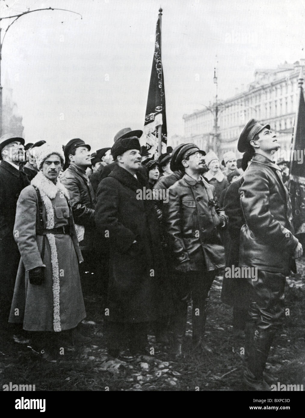 LENIN (centre)  next to Yakov Sverdlov  (in glasses) watch  unveiling of a monument to Marx and Engels, Red Square, Stock Photo
