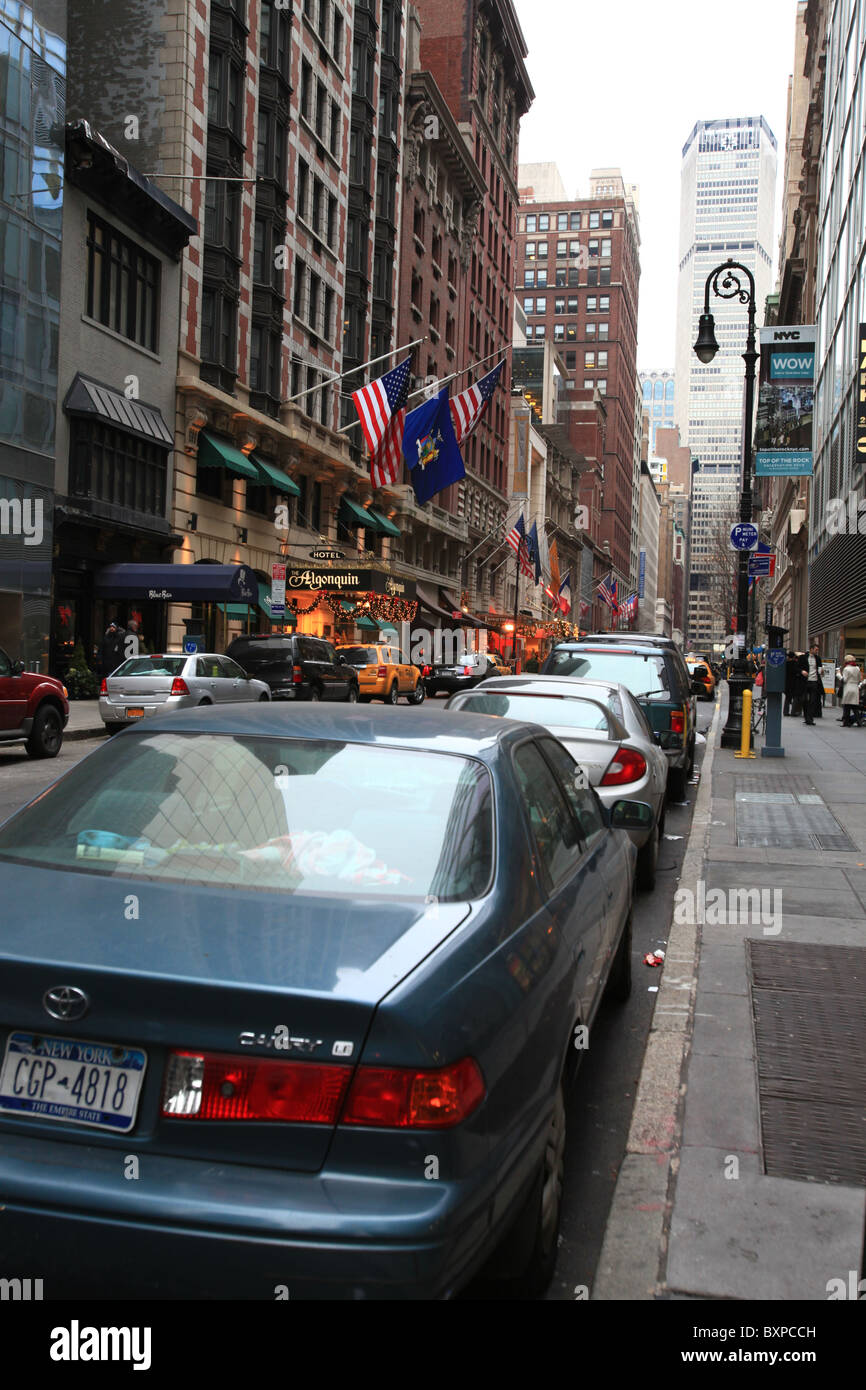 Cars parking on a busy street in Manhattan, New York city, in winter 2010 - Stock Image
