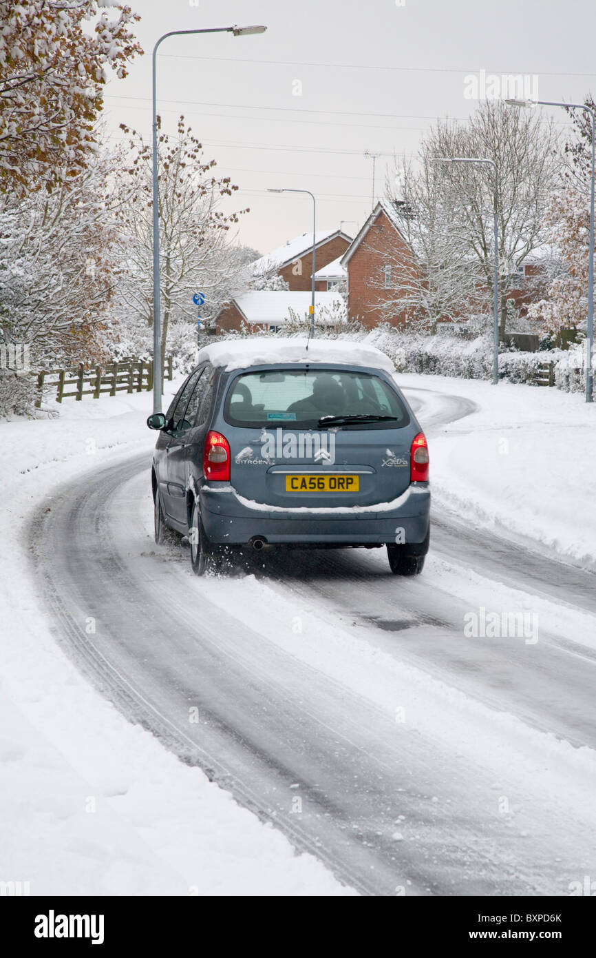 Driving along snowy roads - Stock Image