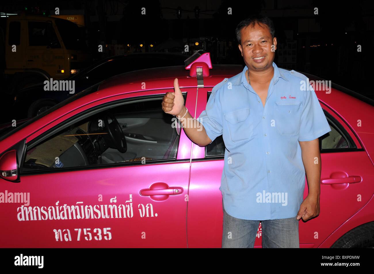 Friendly Taxi Driver in Bangkok - Stock Image