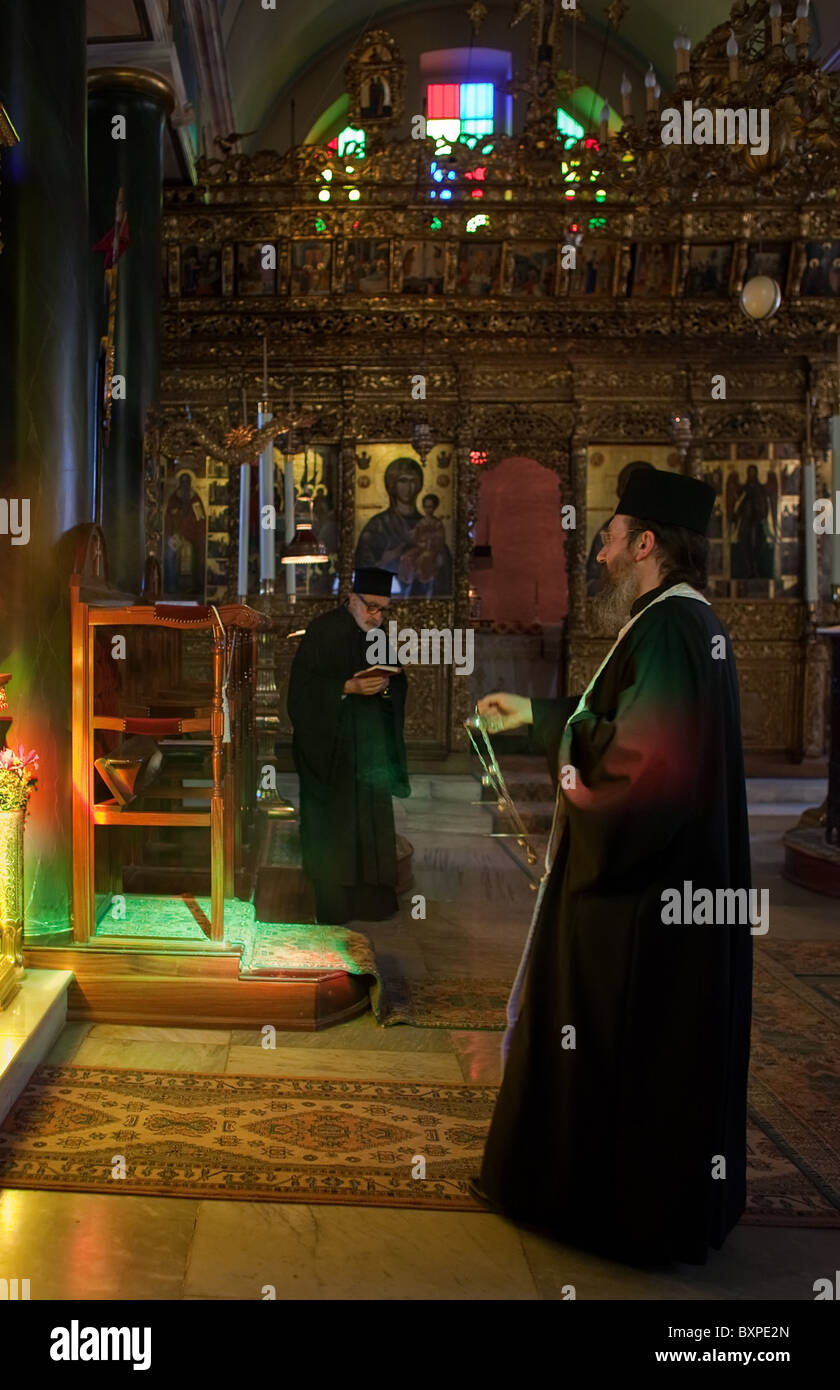 Priest swinging incense during the evening service, Heybeliada, Turkey - Stock Image