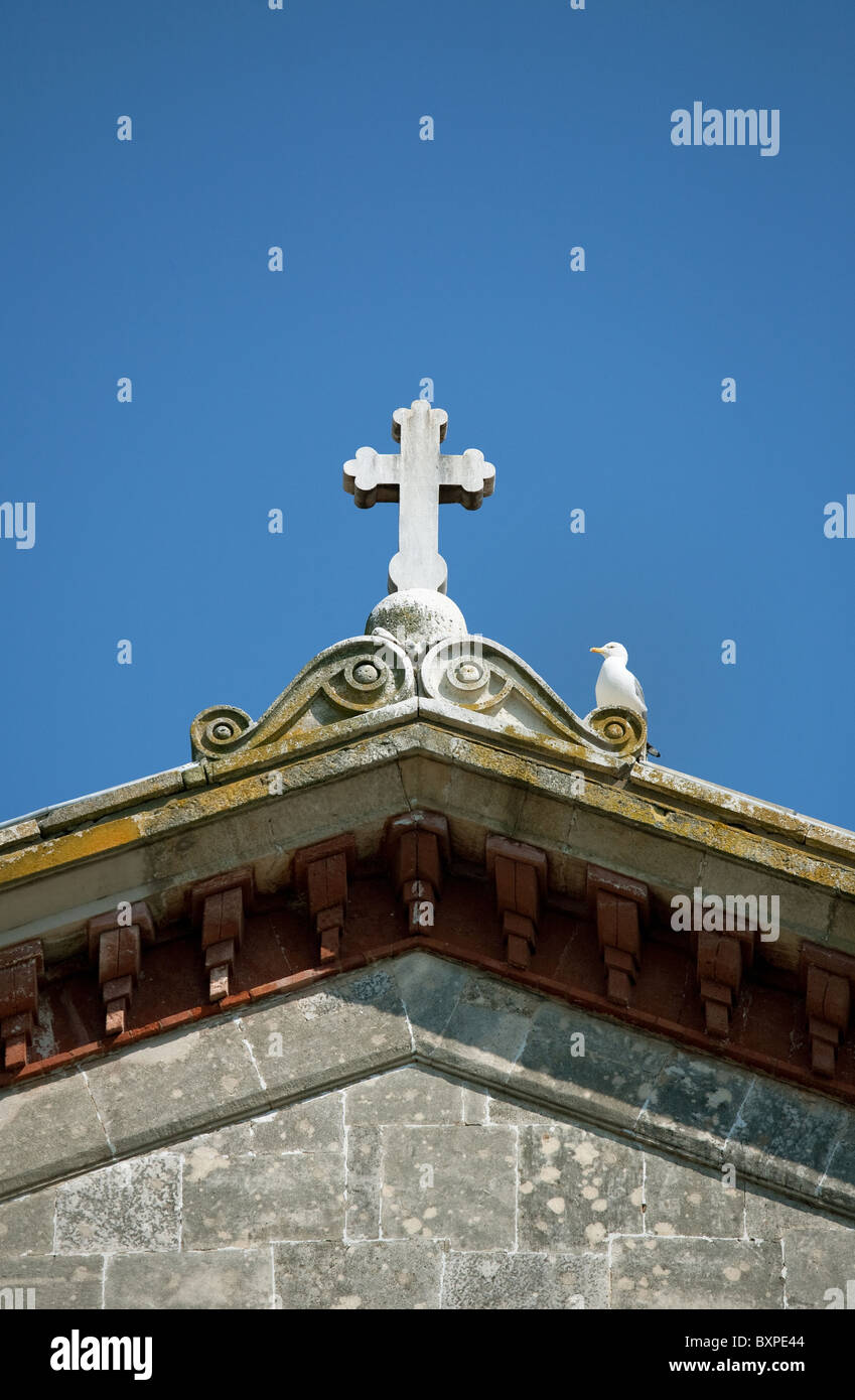 Cross and a seagull on the main building of the Halki Seminary, Heybeliada, Turkey - Stock Image
