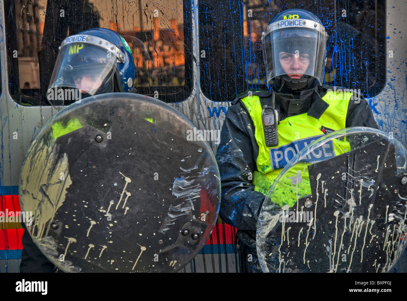 TWO RIOT POLICE IN DYE SMUDGE AFTER THE PROTEST IN PARLIAMENT SQUARE/NOVEMBER 2010 - Stock Image