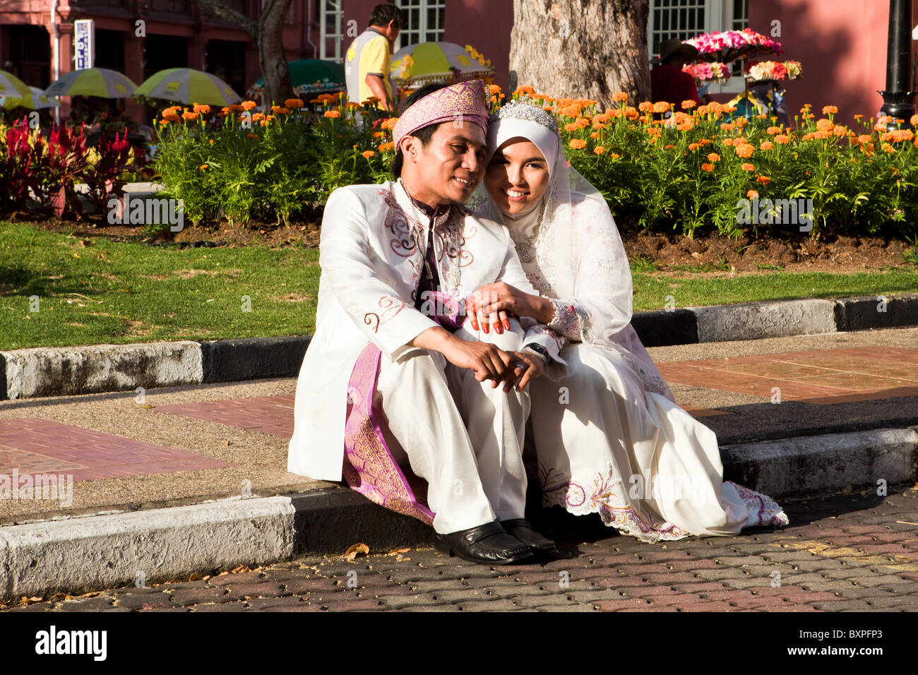 A Malay bride and groom on their wedding day. - Stock Image