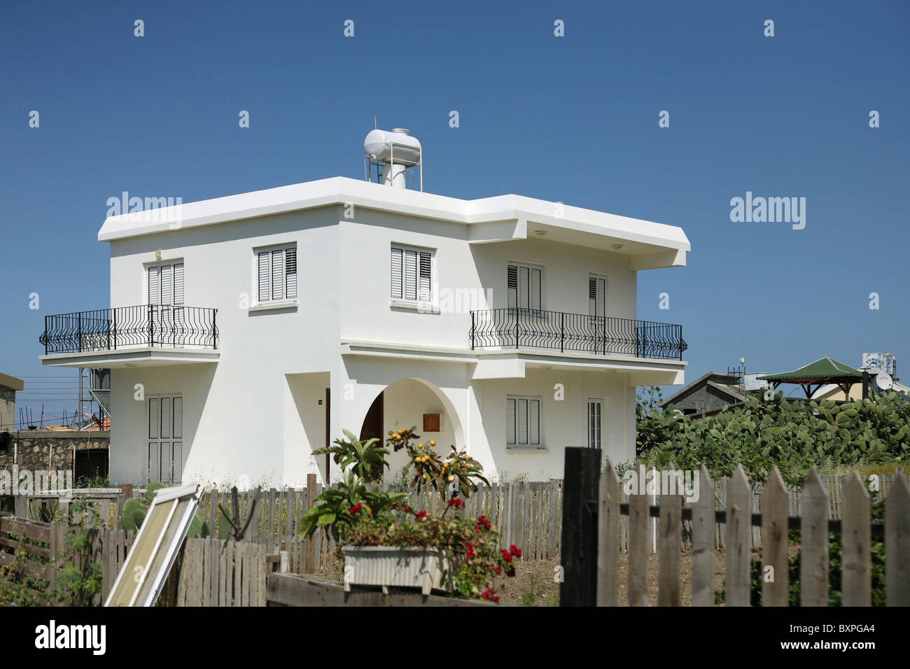 A white detached house, Kyrenia, Turkish Republic of Northern Cyprus - Stock Image