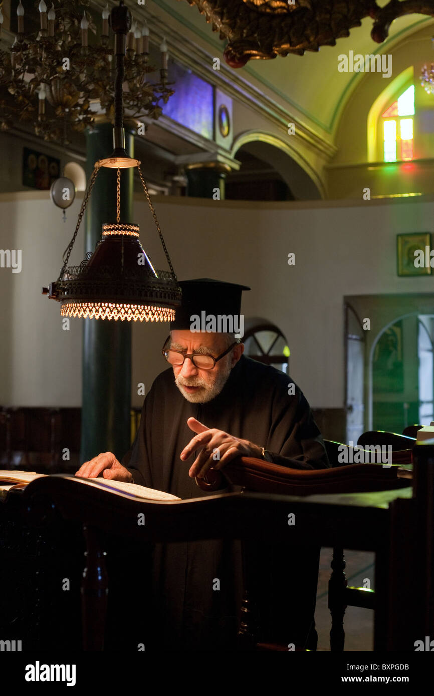 Deacon Dorotheos during the evening service in the Church of the Holy Trinity, Heybeliada, Turkey - Stock Image