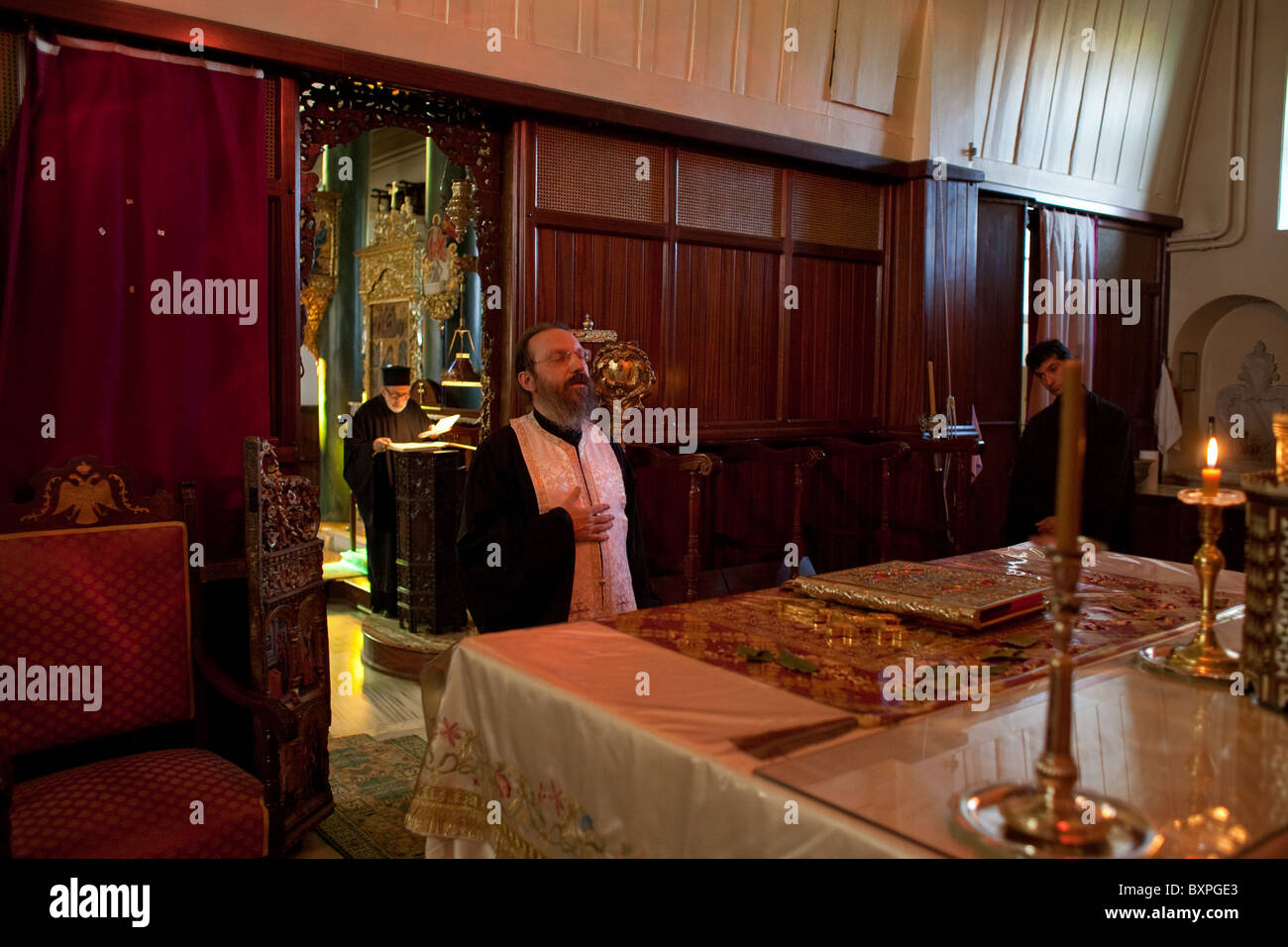 Priest during a mass at the altar in the Church of the Holy Trinity, Heybeliada, Turkey - Stock Image