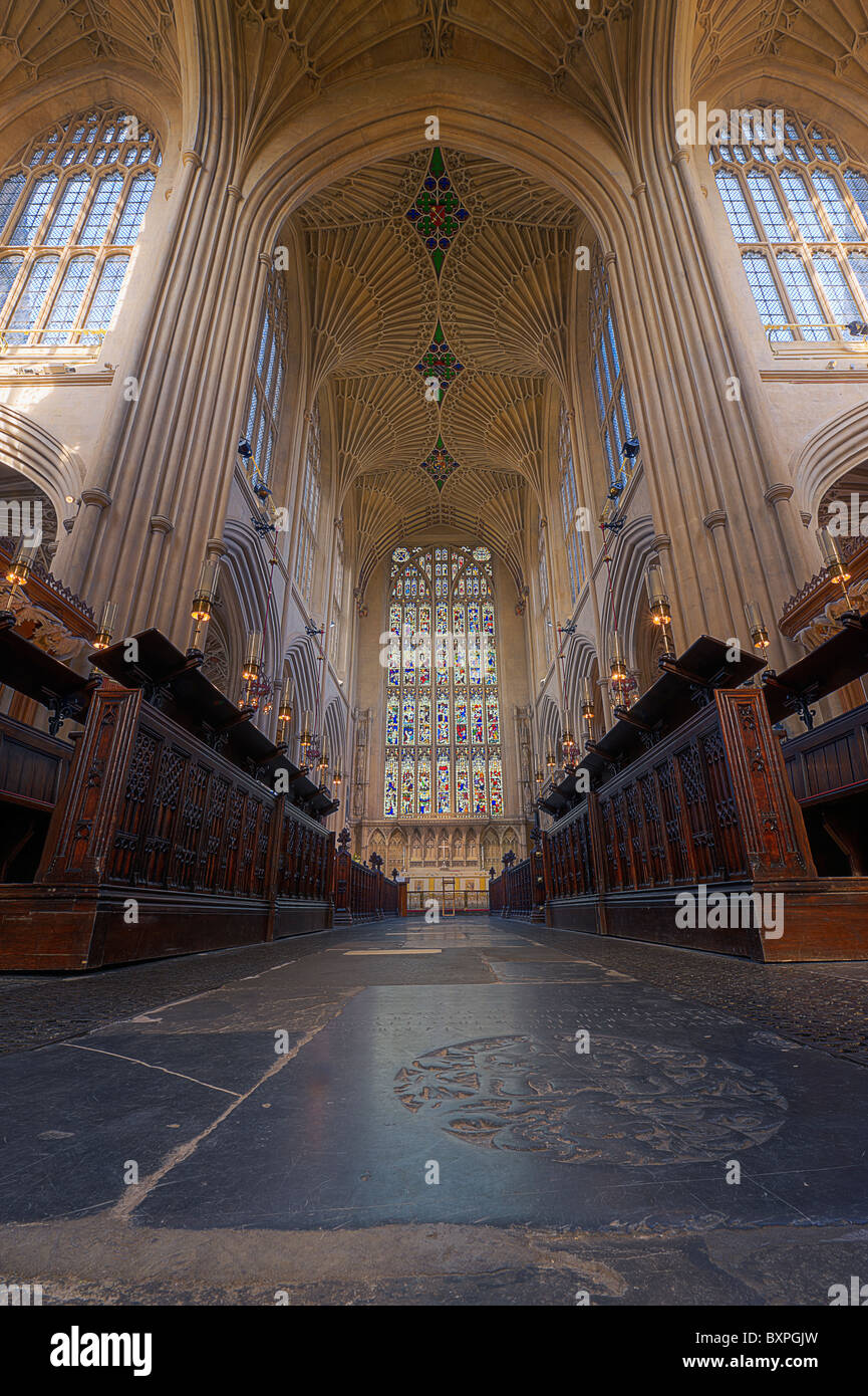 Bath Abbey interior view of the nave with its fan vaulting and heraldic creasts on the ceiling - Stock Image
