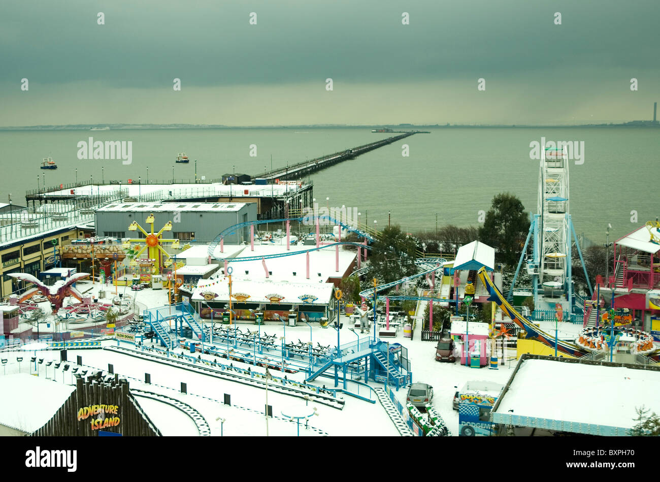 Adventure Island, with Southend pier, in the snow. - Stock Image