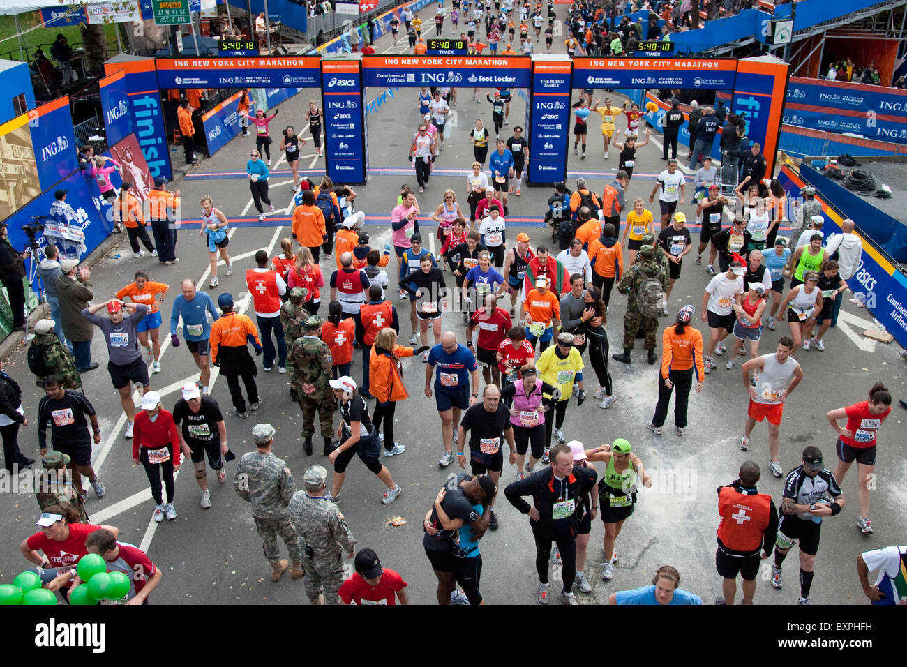 Runners at the finish line in Central Park during 2009 New York City Marathon - Stock Image
