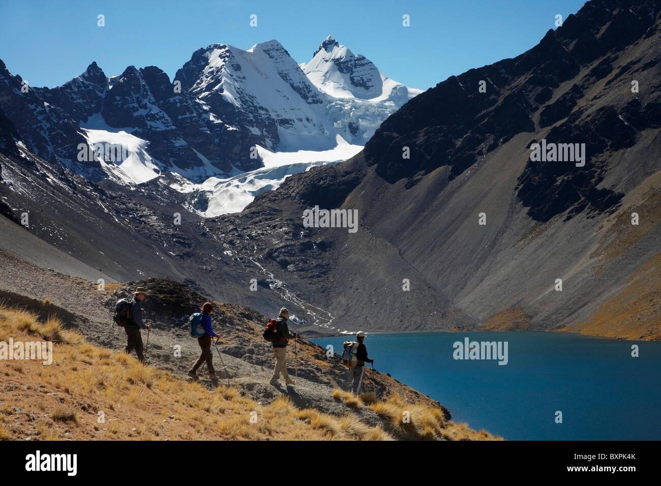 Trekkers With Condorri Peak Behind Stock Photo