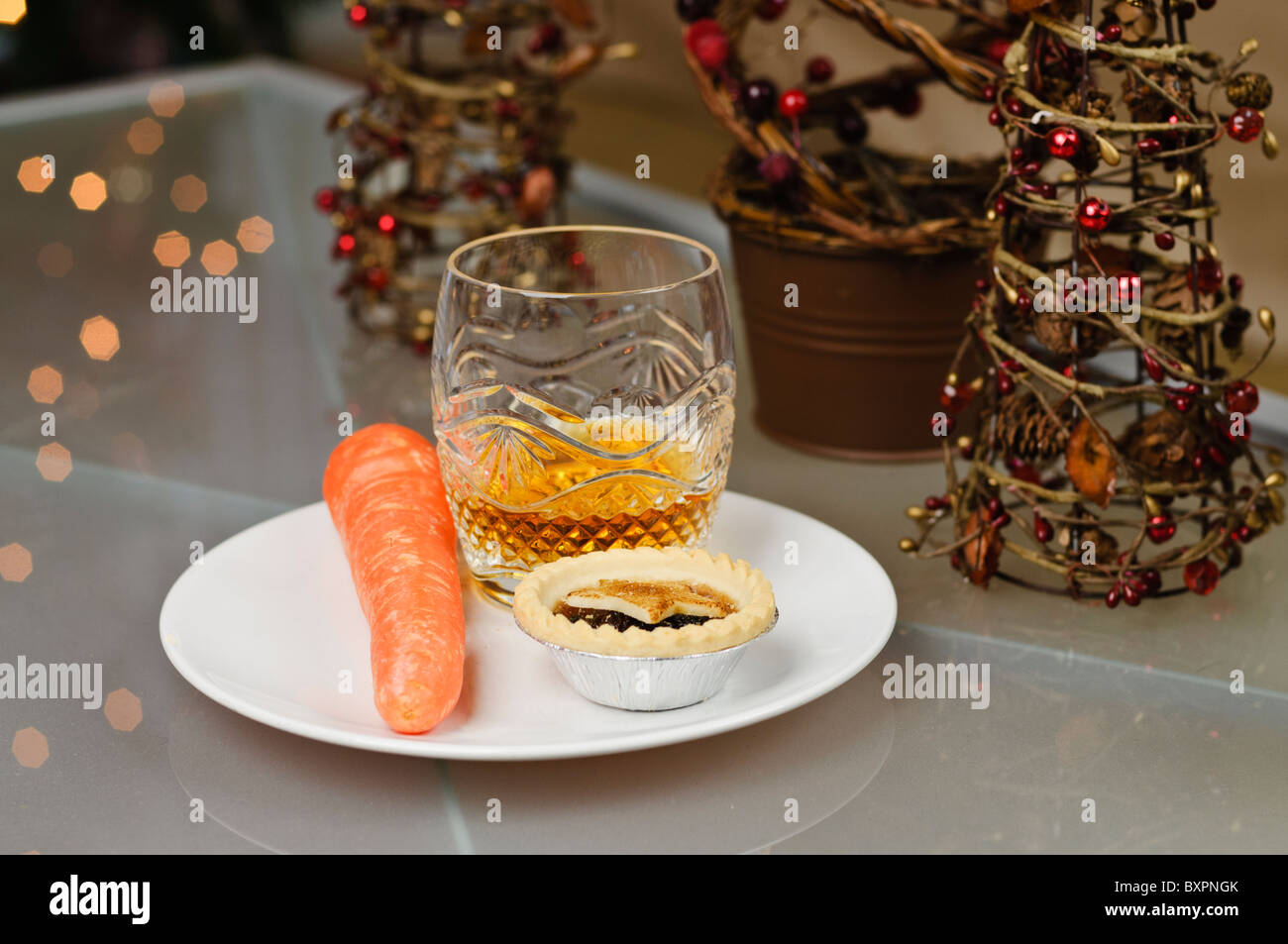 Mince pie carrot and glass of whiskey left on a plate on Christmas Eve for Santa Claus and Rudolph & Mince pie carrot and glass of whiskey left on a plate on Christmas ...