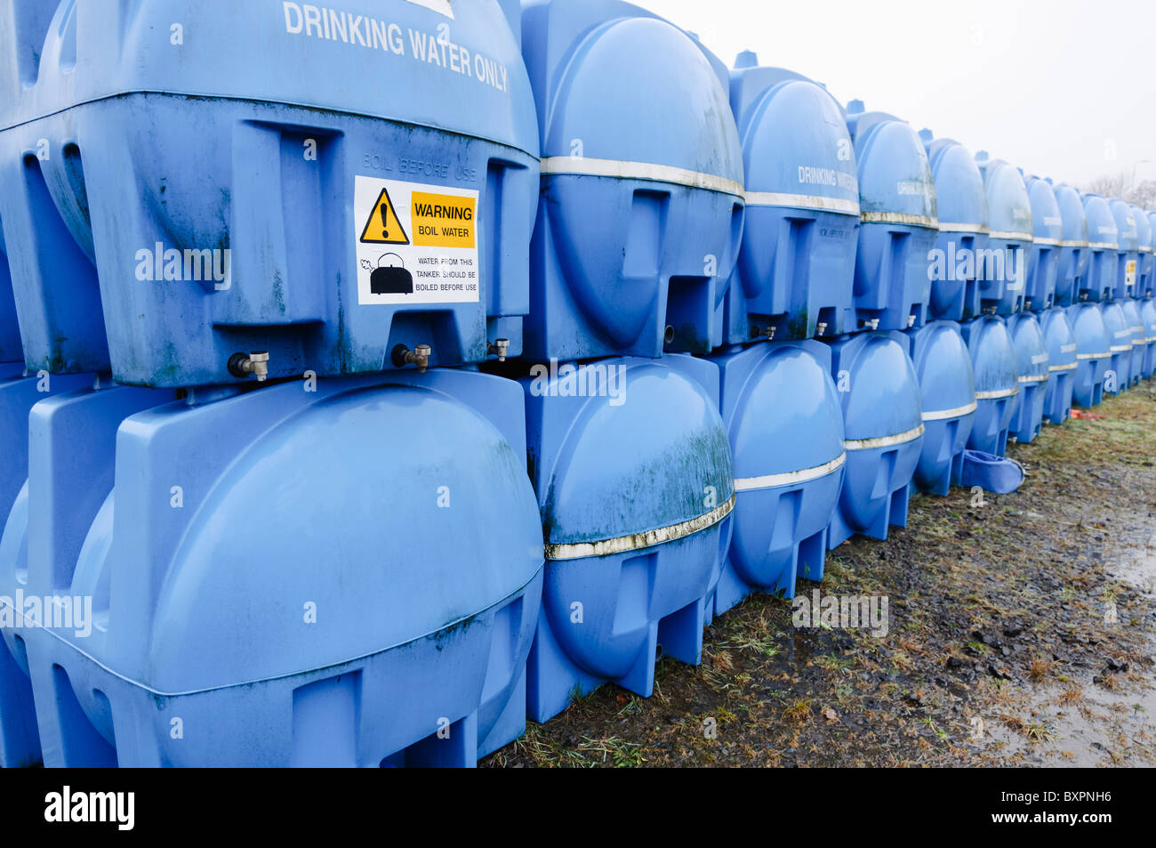 Blue drinking water storage tanks (bowsers) in storage awaiting deployment in an emergency water shortage situation & Blue drinking water storage tanks (bowsers) in storage awaiting ...
