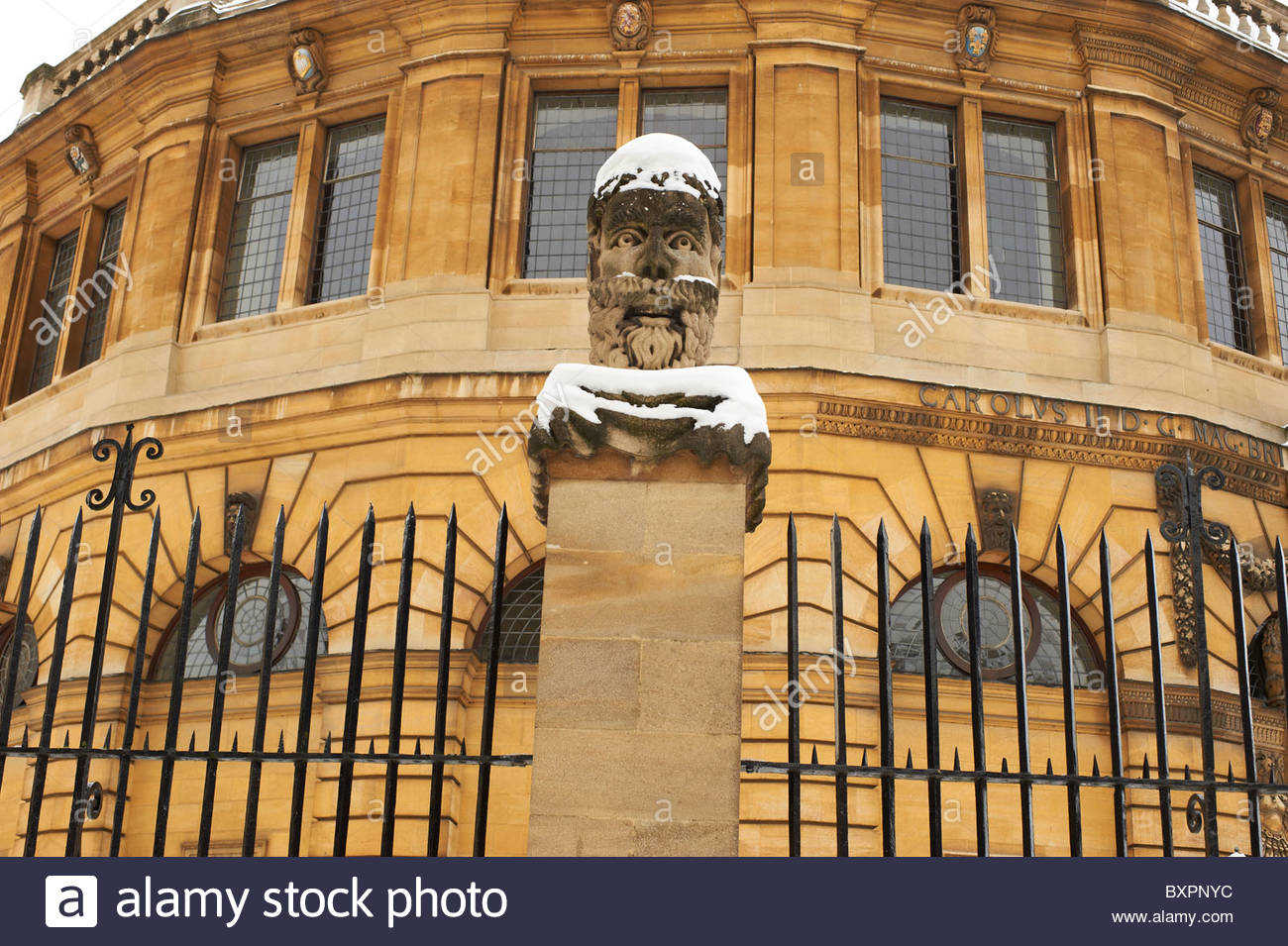 The Sheldonian Theatre and Clarendon Building in Oxford in Winter in the snow Stock Photo