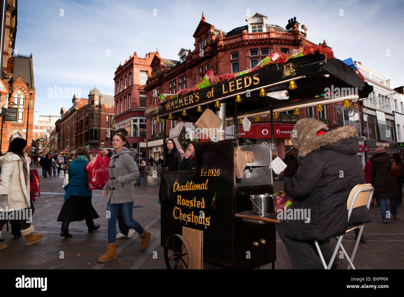 UK, England, Yorkshire, Leeds, Briggate, Walkers of Leeds traditional roasted chestnut vendor at Christmas - Stock Image