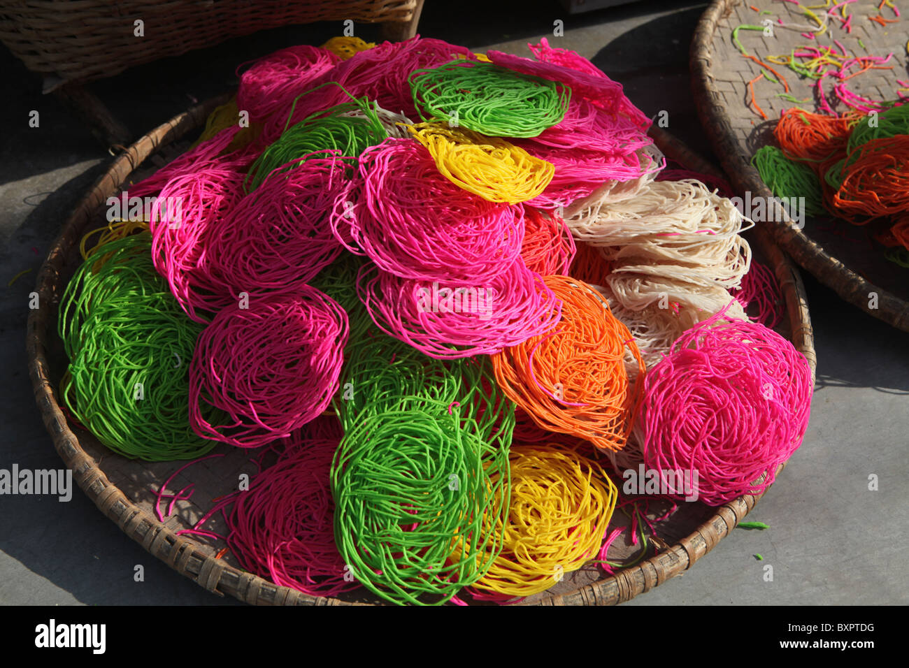 Colourful coloured rice snacks in the city of Pokhara in Nepal. - Stock Image