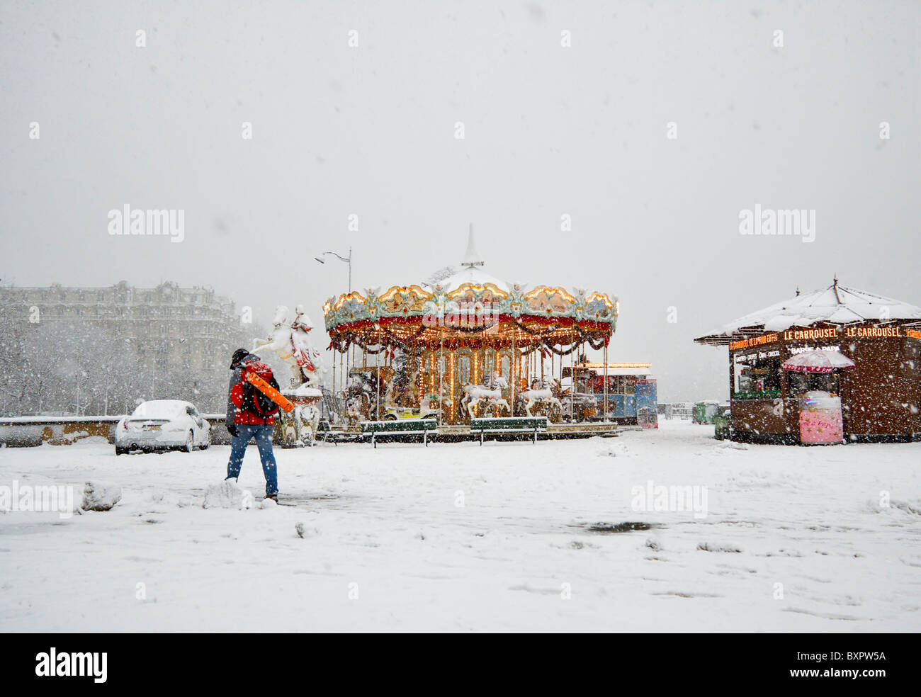 Snow covers tourist attractions and makes pavements and streets slippery during an early winter snowstorm in Paris, - Stock Image