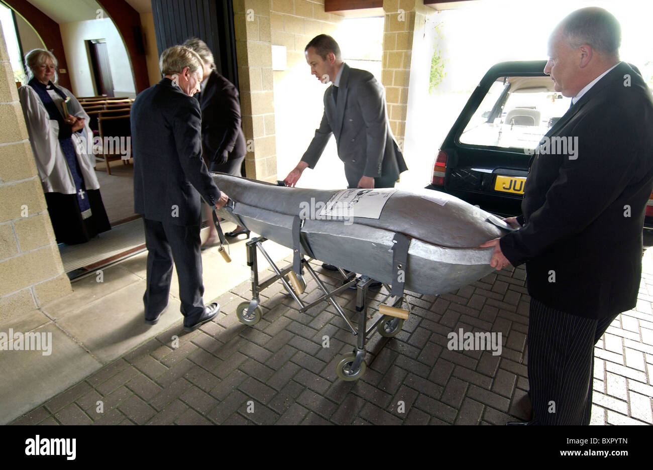 An environmentally friendly Eco-pod coffin being delivered for a natural burial funeral service - Stock Image