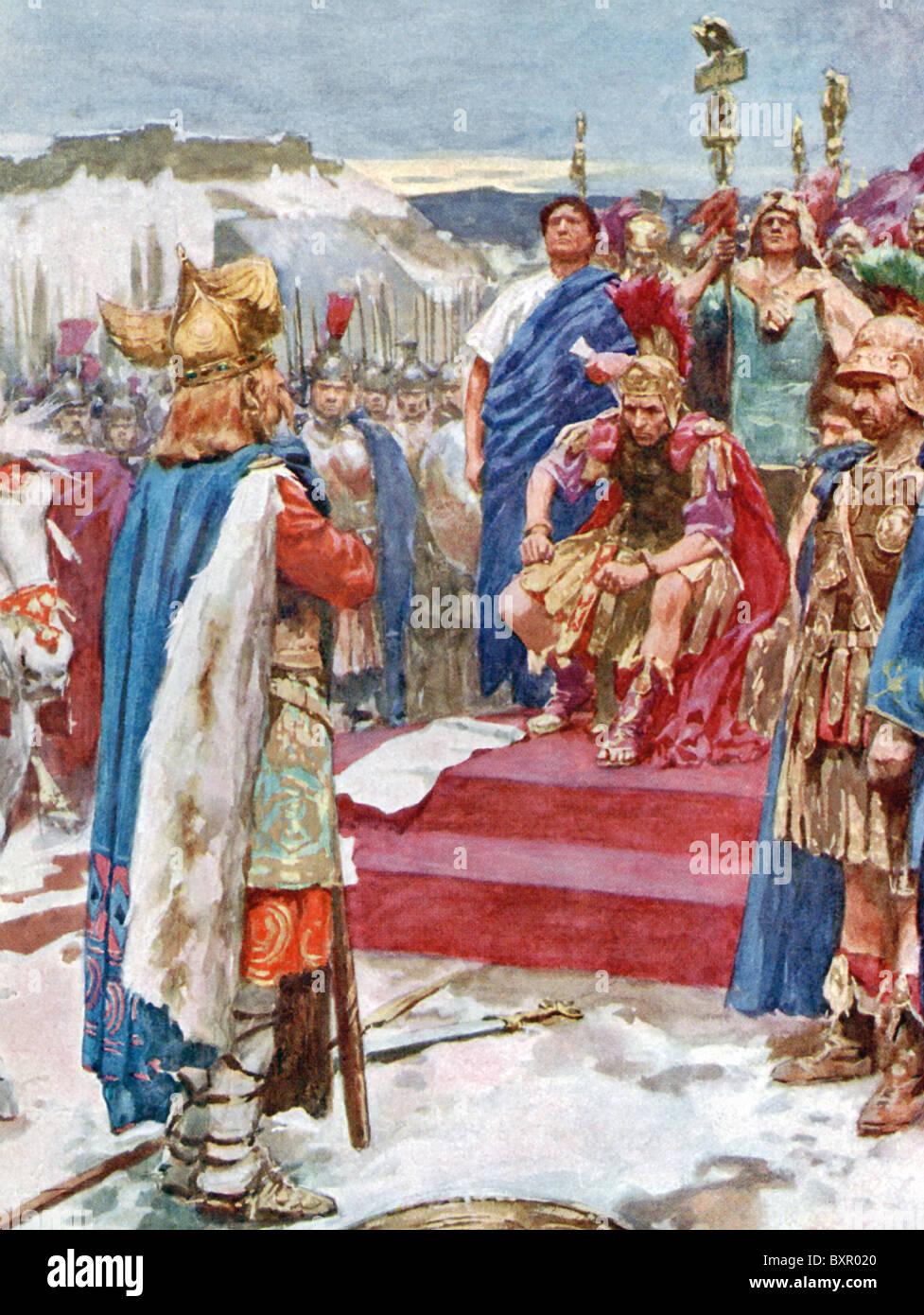 Gallic chieftain Vercingetorix officially surrenders his sword and himself to Julius Caesar. - Stock Image