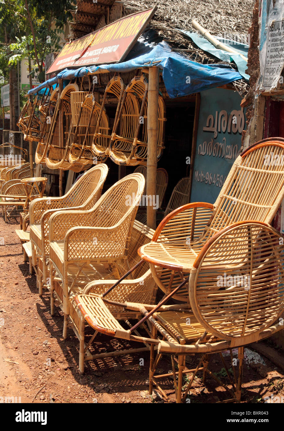 A shop manufacturing traditional indian wicker furniture displays its goods outside its premises in Varkala, Kerala, - Stock Image