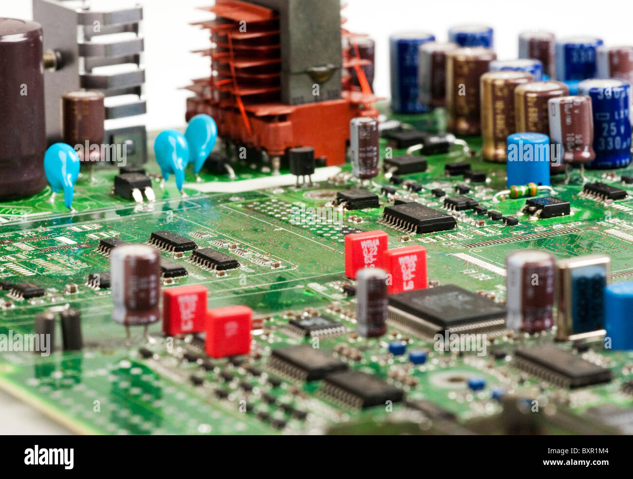 printed circuit board showing various electronic components - Stock Image