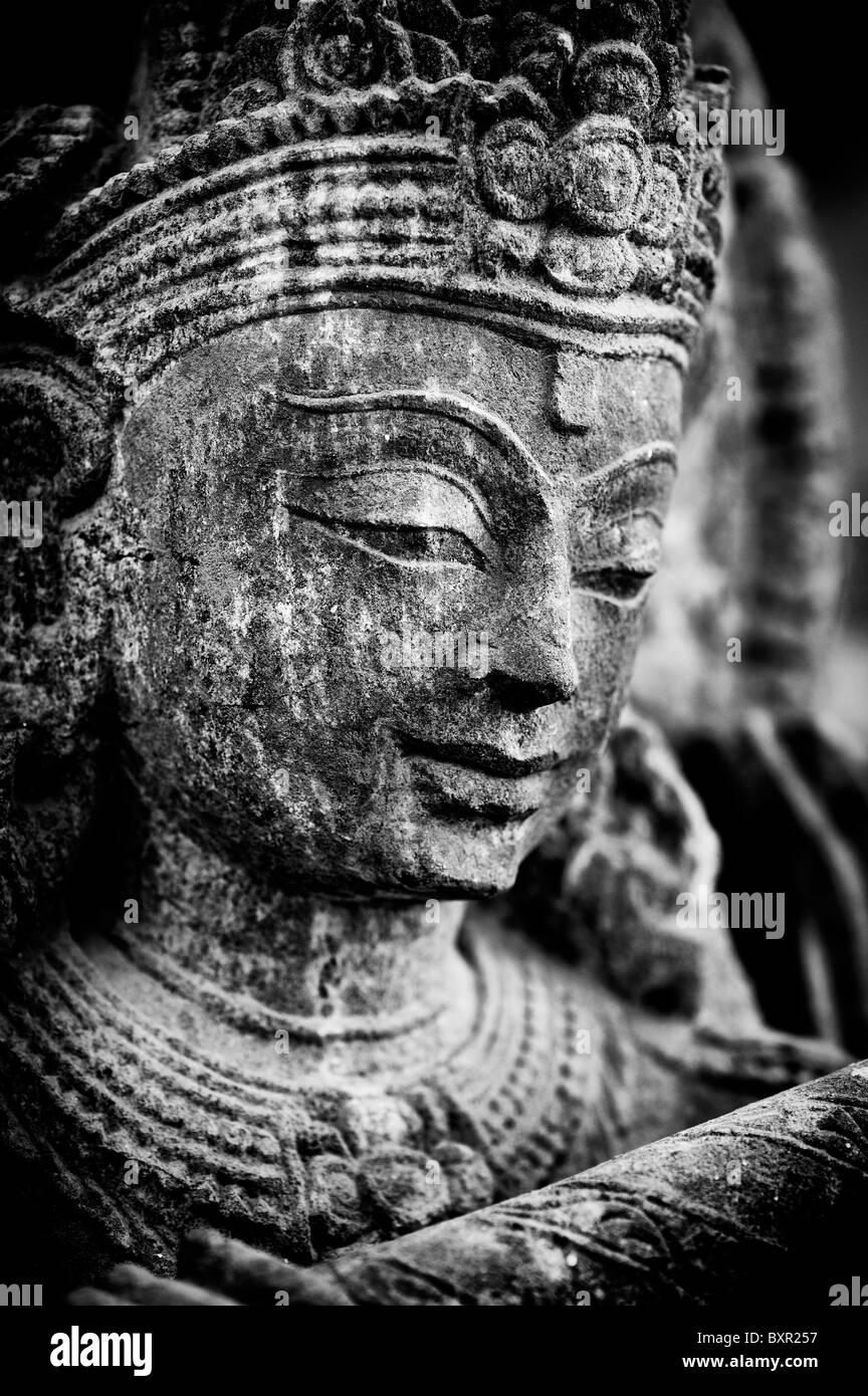 Granite stone Krishna statue. Worshiped hindu Indian deity. Andhra Pradesh, India. Monochrome - Stock Image